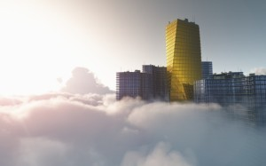 A gold colored tower overlooking clouds
